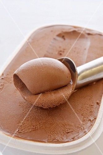 Chocolate ice cream in a plastic container (close-up)