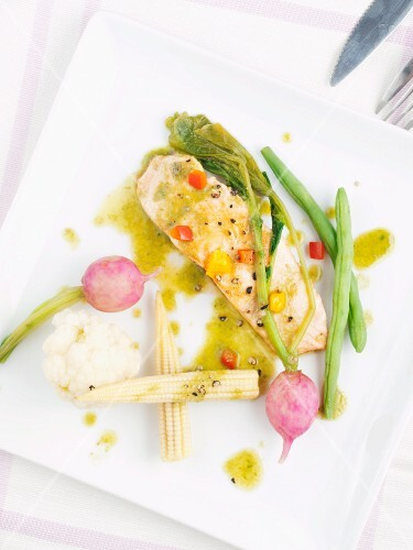 Salmon with anchovy sauce and vegetables