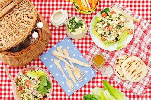 Bulgur salad with chickpeas and feta, romain lettuce and home-made hummus for picnic