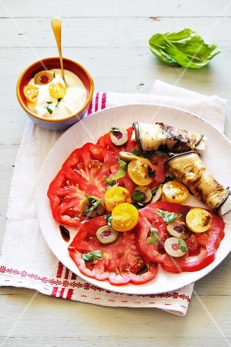 Tomato salad with olives and rolled aubergine slices
