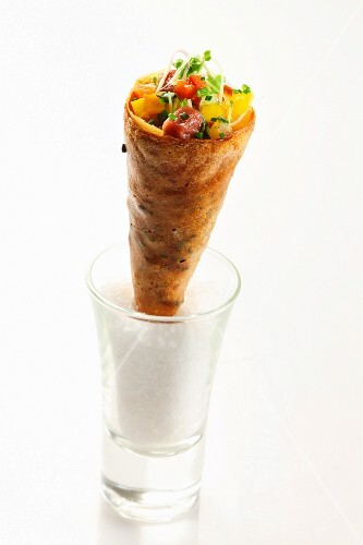 Tuna with vegetables and edible shoots in a wafer cone