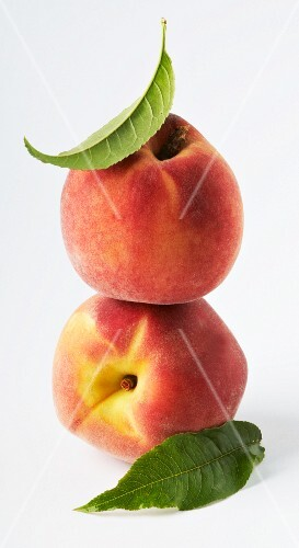 Two peaches, stacked