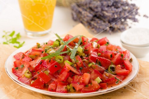 Tomato salad with olives, fresh herbs and spring onions