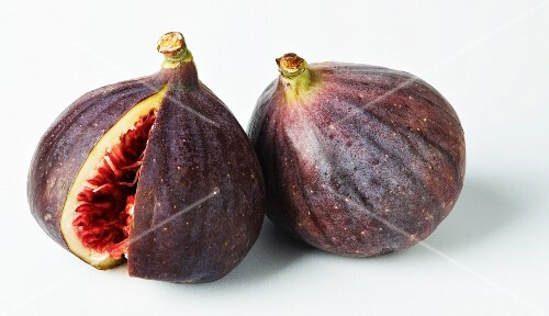 Two figs, one with a wedge cut out