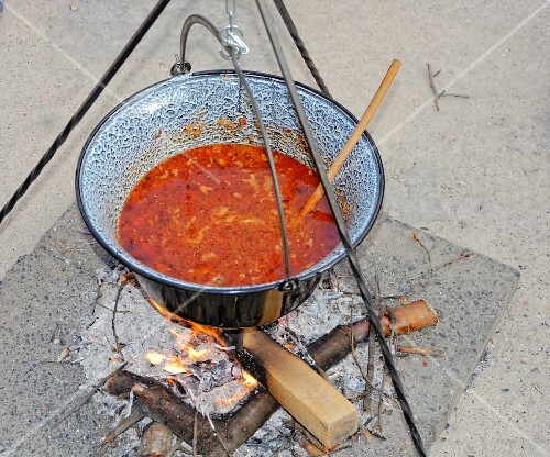 Hungarian bean stew in a pot cooked over an open fire