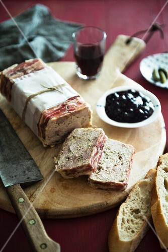 Terrine wrapped in bacon with chunks of baguette