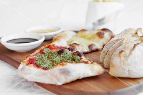 Assorted breads with pesto and olive oil