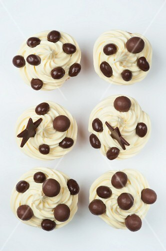 Cupcakes with cream icing and chocolate decoration