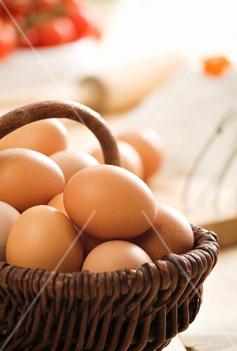 Fresh eggs in a willow basket