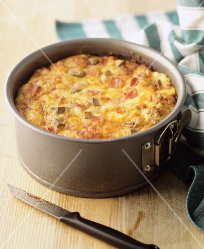 A small vegetable cake with bacon in a spring-form cake tin