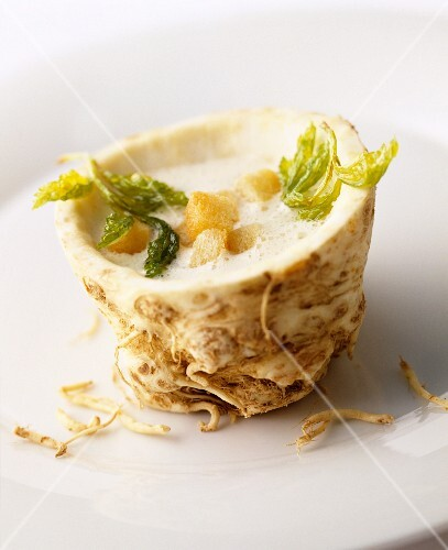 Cream of celeriac soup with croutons in a hollowed-out celeriac