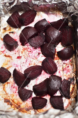 Roasted beetroot on the baking tray with aluminium foil