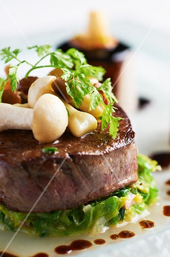 Beef medallion with mushrooms and chervil (close-up)