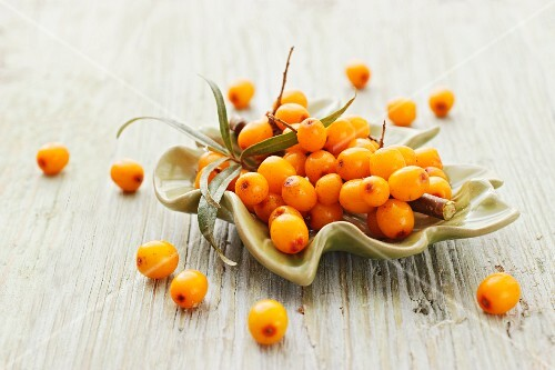 Sea buckthorn berries in a leaf-shaped bowl