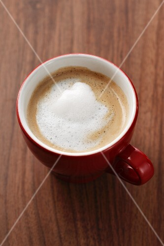 A cup of coffee with frothed milk