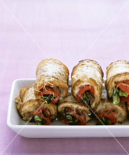 Rolls of pork stuffed with vegetables and cheese
