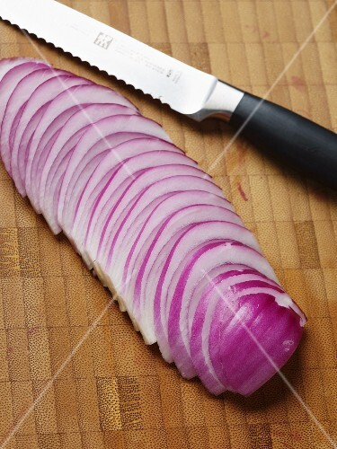 A red onion cut into slices