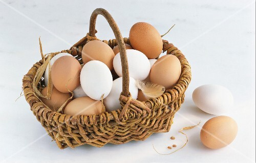 White and brown eggs in a basket
