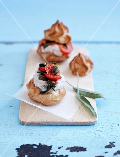 Profiteroles with tuna mousse, tomatoes, capers and sage