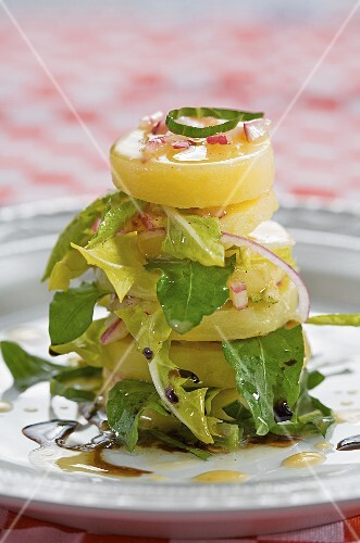 Layered potato tower with rocket and vinaigrette