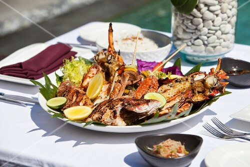 Fish and seafood platter on a table outdoors