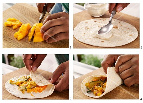 Wraps with mango and chicken being made
