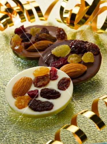 Chocolate buttons with dried fruits and almonds