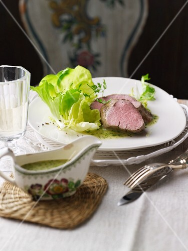Poached fillet of veal with a herb sauce and lettuce