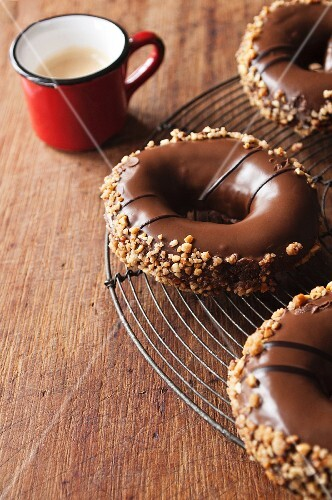 Doughnuts with chocolate glaze and chopped nuts