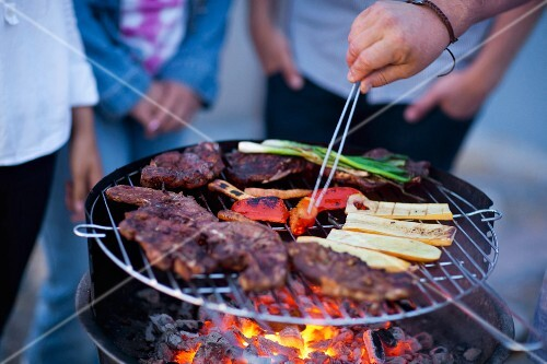 Barbecue with vegetables on barbecue grill