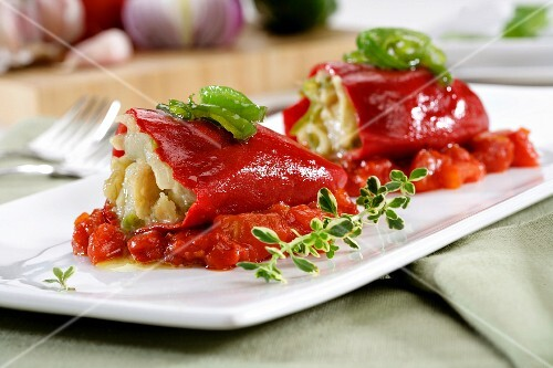 Peppers stuffed with cod on stewed tomatoes