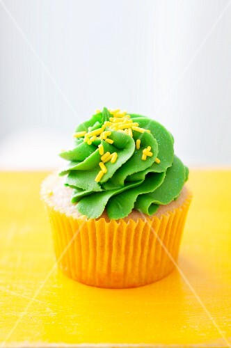 Orange cupcake with lime icing
