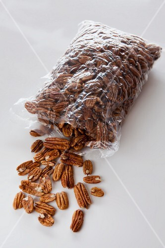 Pecan nuts spilling out of a plastic bag