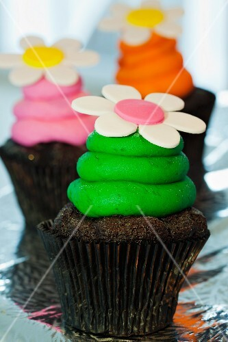 Chocolate cupcakes with colourful buttercream and sugar flowers
