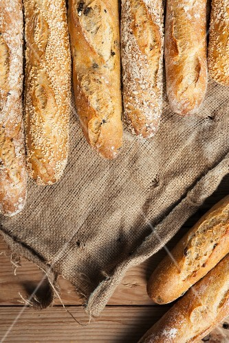 Several baguettes lying on jute