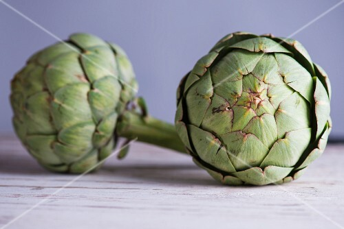 Two green artichokes