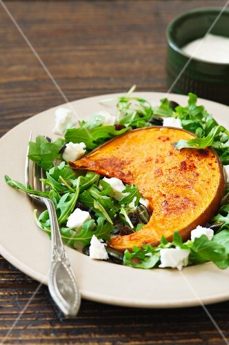 Baked squash on rocket salad with feta