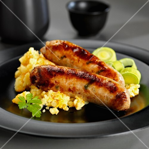 Fried sausages with mashed potato, leek and ginger