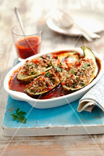Courgettes stuffed with minced meat and rice, in tomato sauce
