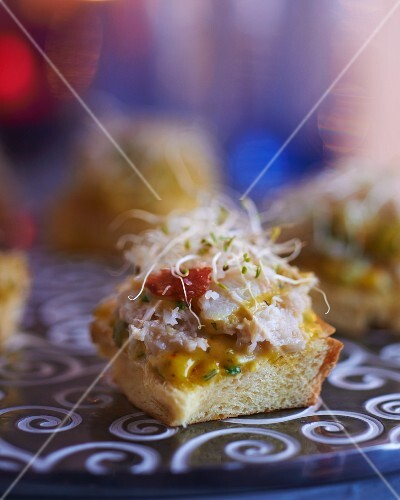 Canapés with crab meat and edible shoots