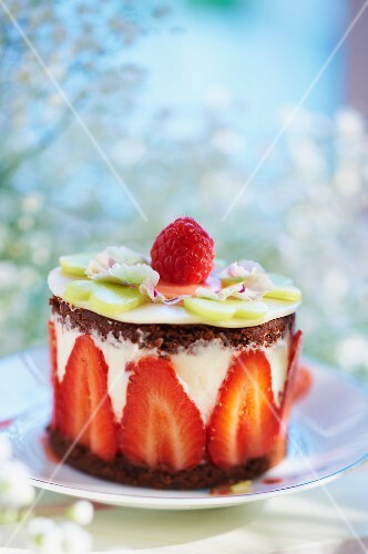 Individual chocolate layer cake with yoghurt and strawberries