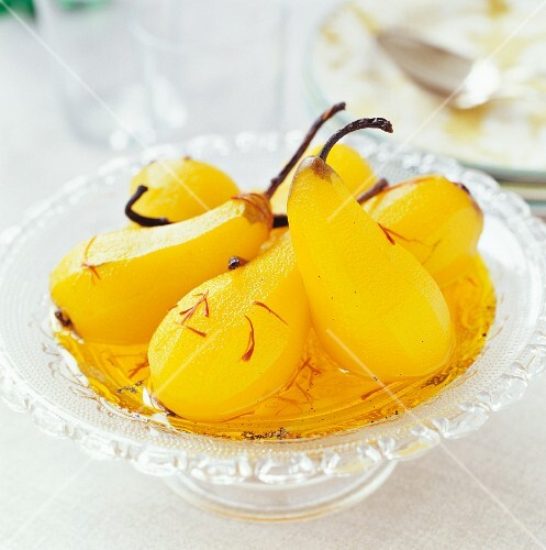 Poached pears in saffron sauce