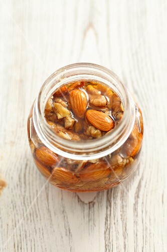 Walnuts and almonds in honey