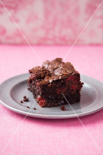 Brownie with raspberries and cranberries