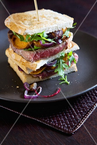 Beef steak, onion and ricotta sandwich