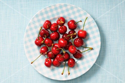 Fresh cherries on a checked plate