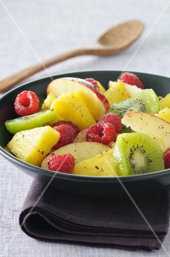 Fruit salad with pineapple, raspberries, apple and kiwi