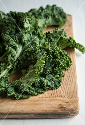 Fresh kale on a chopping board