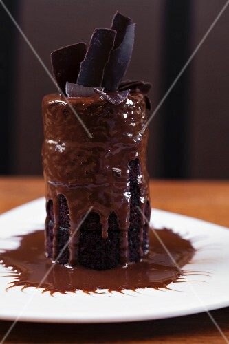 Tall Molten Lava Chocolate Cake on a White Plate
