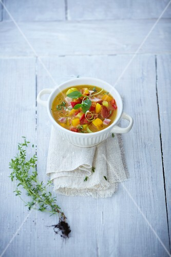 Squash soup with thyme, basil and ham